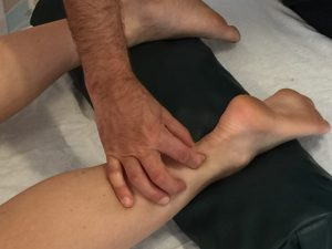 The pinch test for Achilles tendinitis. Permission: Joseph E. Muscolino.