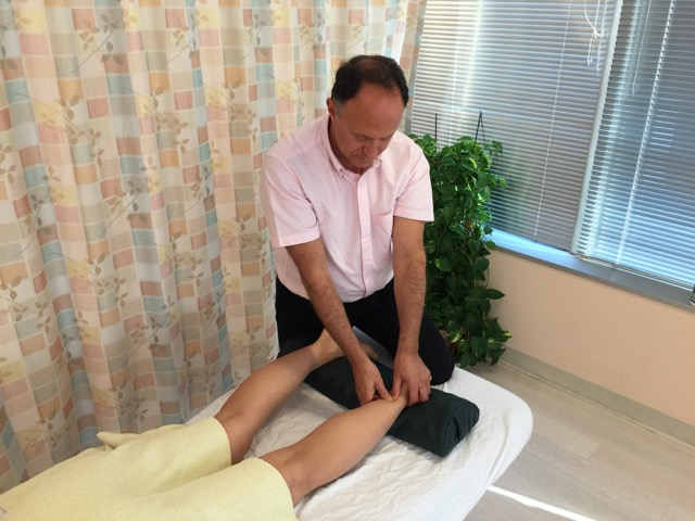 Cross-fiber soft tissue manipulation (massage) to the Achilles tendon. Permission: Joseph E. Muscolino.