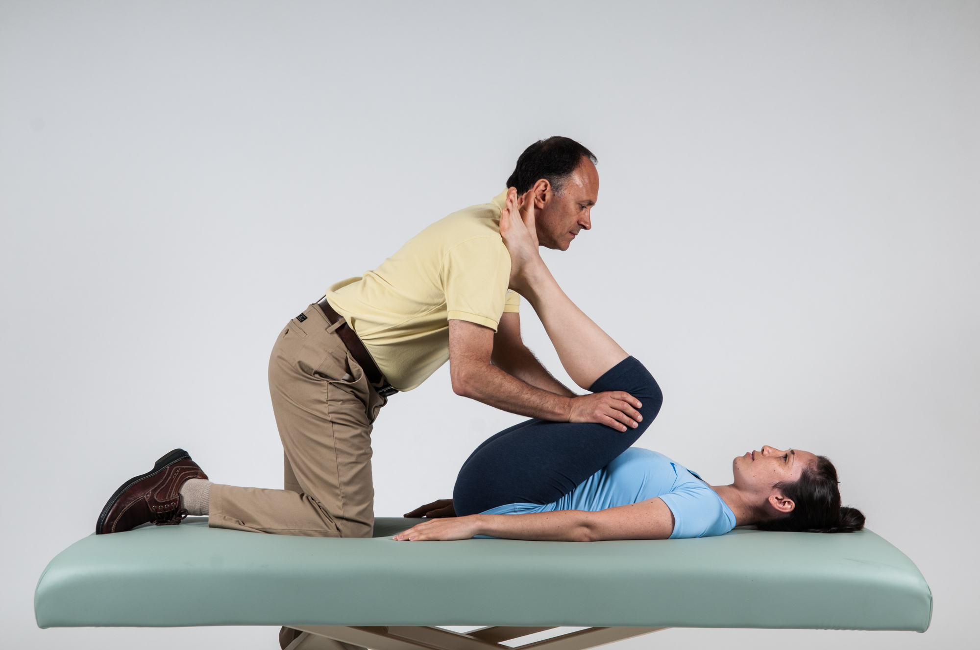 Therapist assisted double knee to chest stretch for the client with lower crossed syndrome. Permission: Joseph E. Muscolino. Manual Therapy for the Low Back and Pelvis (2015).