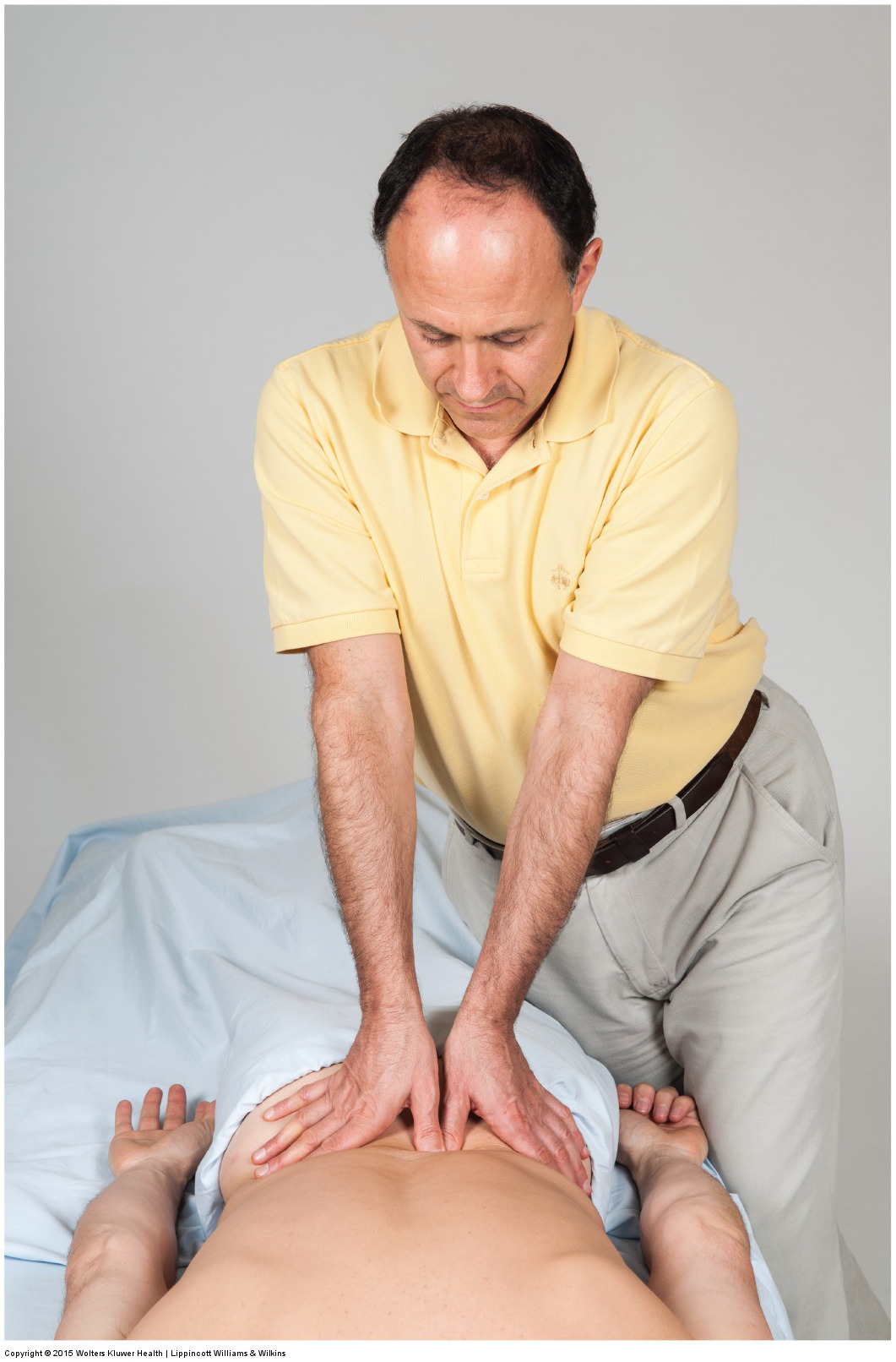Using the core to generate deep pressure massage into the low back with braced thumb contact. Permission: Joseph E. Muscolino. Manual Therapy for the Low Back and Pelvis (2015).