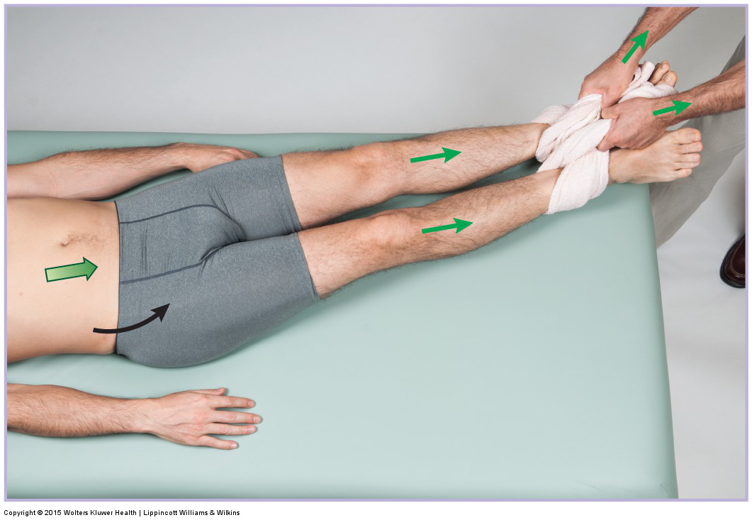 Traction for the lumbar spine with left lateral flexion added in. Permission: Joseph E. Muscolino. Manual Therapy for the Low Back and Pelvis (2015).