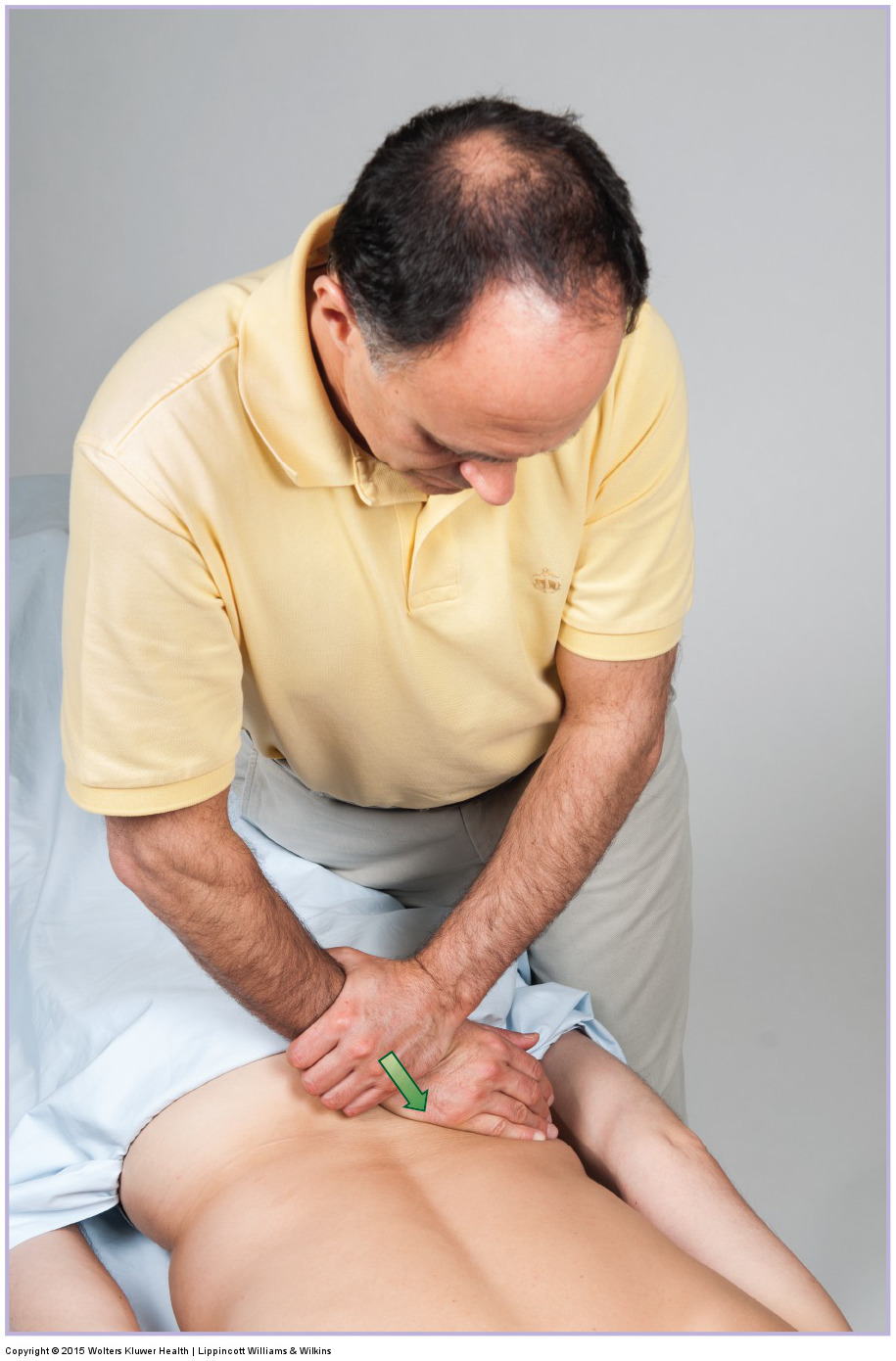 Motion palpation assessment (and joint mobilization treatment) for the left sacroiliac joint. Permission: Joseph E. Muscolino. Manual Therapy for the Low Back and Pelvis (2015).