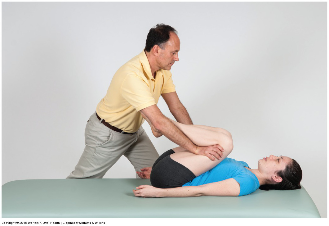 Double knee to chest stretch for the posterior paraspinal musculature. Permission: Joseph E. Muscolino. Permission: Joseph E. Muscolino. Manual Therapy for the Low Back and Pelvis (2015).