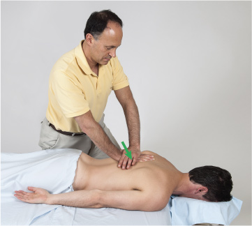 Joint mobilization (arthrofascial stretching) technique performed on the thoracic spine.