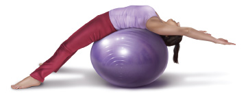Lying supine on a fitness ball to passively bring the spine into extension for slumped spinal posture. Permission: Joseph E. Muscolino.